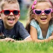 Cute small kids with fancy sunglasses — Stock Photo