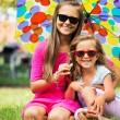 Foto Stock: Two sisters smiling to camera
