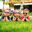 Stock Photo: Trio kids showing their tongues