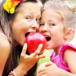 Joyful cute kids sharing an apple — Foto Stock