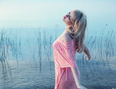 Sensual blonde girl enjoying cold lake water — Stock Photo