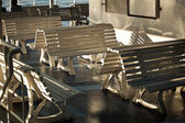 Photo of a couple of wooden benches — Stock Photo