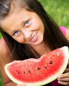 Cute girl eating juicy watermelon — Stock Photo