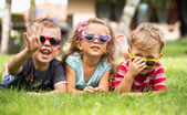Three cheerful kids playing together — Stock Photo