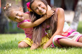 Smiling cute sisters playing together — Stock Photo