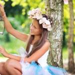 Cute girl holding retro parrafin lamp — Stock Photo
