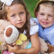Stock Photo: Glad kids holding cute teddy bear