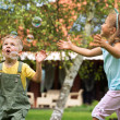 Children playing at the garden — Foto Stock