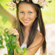 Pretty young girl smiling to the camera — Stock Photo