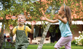 Children playing at the garden — Stock Photo