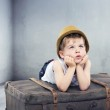 Little boy dreaming about toys — Stock Photo