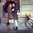 Elegant couple with umbrella on rainy evening — Stockfoto