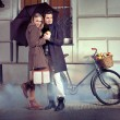 Elegant couple with umbrella on rainy evening — Stock Photo
