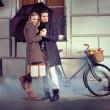 Elegant couple with umbrella on rainy evening — Stock Photo