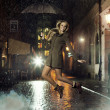 Fantastic photo of attractive girl jumping in heavy rain — Stockfoto