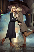 Blonde girl kissing her friend's chick — Stock Photo