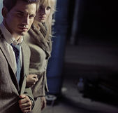 Beautiful young couple walking together in night city — Stock Photo