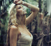 Young sexy woman in jungle — Stock Photo