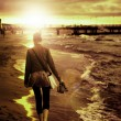 Art picture of young woman walking by the seaside — Stock Photo