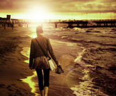 Art picture of young woman walking by the seaside — 图库照片