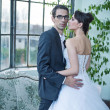 Attractive wedding couple after big party — Stock fotografie