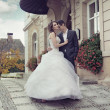 Young wedding couple dancing outdoor — Stockfoto