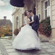 Young wedding couple dancing outdoor — Stock Photo
