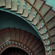 Ancient interior with old wooden spiral stairs — Stock Photo