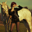 Redhead lady with majestic horse — Stock Photo #35626945