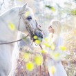 Blonde nymph with white horse — Stockfoto #35627167
