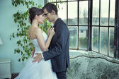 Picture presenting cute wedding couple — Stock Photo