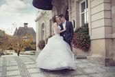Young wedding couple dancing outdoor — Stock Photo