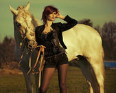 Redhead lady with majestic horse — Foto de Stock