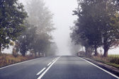 Empty road behind the small countryside — Stock Photo