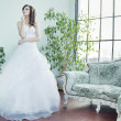 Attractive brunette bride thinking about future — Stock Photo