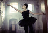 Black swan ballet dancer in move — Stock Photo