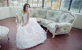 Stressed bride wearing beautiful wedding gown — Photo