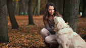 Attractive lady with her labrador dog — Stock Photo