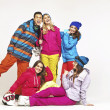 Lucky snowboard guy with four pretty women — Stock Photo