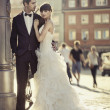 Young attractive marriage couple in the old town — 图库照片