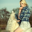 Stock Photo: Mystery blonde womriding horse