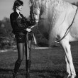 Black&white phoyo of redhead lady with horse — Stock Photo