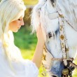 Sensual blonde nymph and majestic horse — Stock fotografie