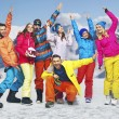 Stock Photo: Smiling snowboarders in funny poses