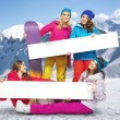 Group of female snowboarders with bright boards — Stock fotografie