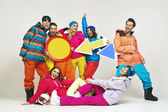 Colorful photo of the glad snowboarders — Stock Photo