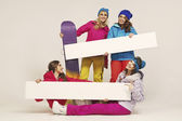 Group of the cheerful female snowboarders — Stock Photo