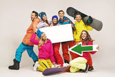 Laughing snowboarders presenting new equipment — Foto Stock