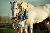 Portrait of a beauty blondie with horse — Foto Stock