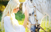 Sensual blonde nymph and majestic horse — Stok fotoğraf